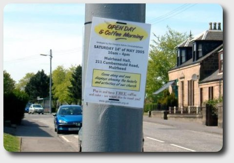Poster advertising the open day attached to a lamp post.